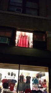 Balamachi's lit display window sits above Isabella's Collection on Park and Dewey Streets.